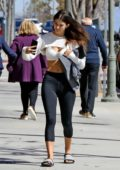 Camila Morrone flaunts her toned abs while taking a few selfies as she heads to her pilates class in Los Angeles
