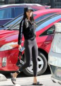 Chantel Jeffries rocks a cropped black jacket, black leggings and Fendi slippers during her trip to a nail salon in Los Angeles