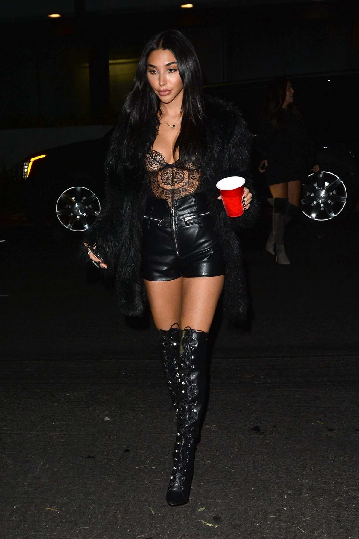 Chantel Jeffries sizzles in a black corset and leather shorts at Nikita Dragun's birthday bash in West Hollywood, Los Angeles