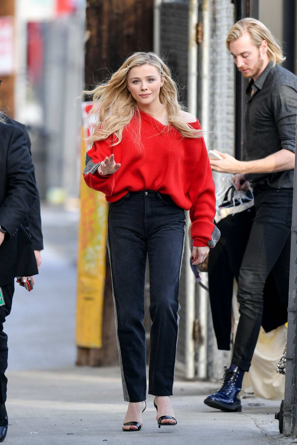 Chloe Grace Moretz stands out in a bright red sweater as she arrives for her appearance on Jimmy Kimmel Live! in Los Angeles