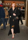 Christina Hendricks wore a black coat with a black floral print dress while arriving at the NBC Studios in New York City