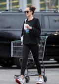 Dakota Johnson steps out without makeup in a black sweatshirt and leggings while shopping groceries in Los Angeles