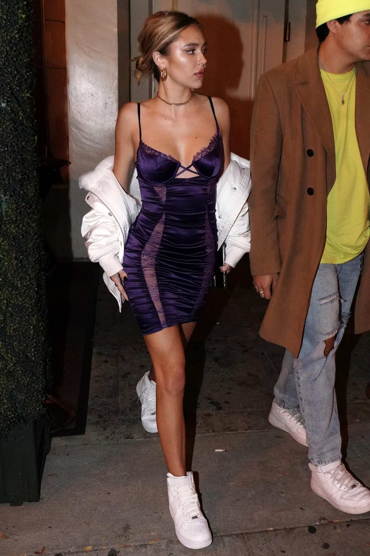 Delilah Belle Hamlin seen wearing a deep neck purple dress during a night out Delilah Nightclub in West Hollywood, Los Angeles