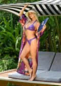 Demi Rose poses in a purple latex bikini during a photoshoot in Thailand