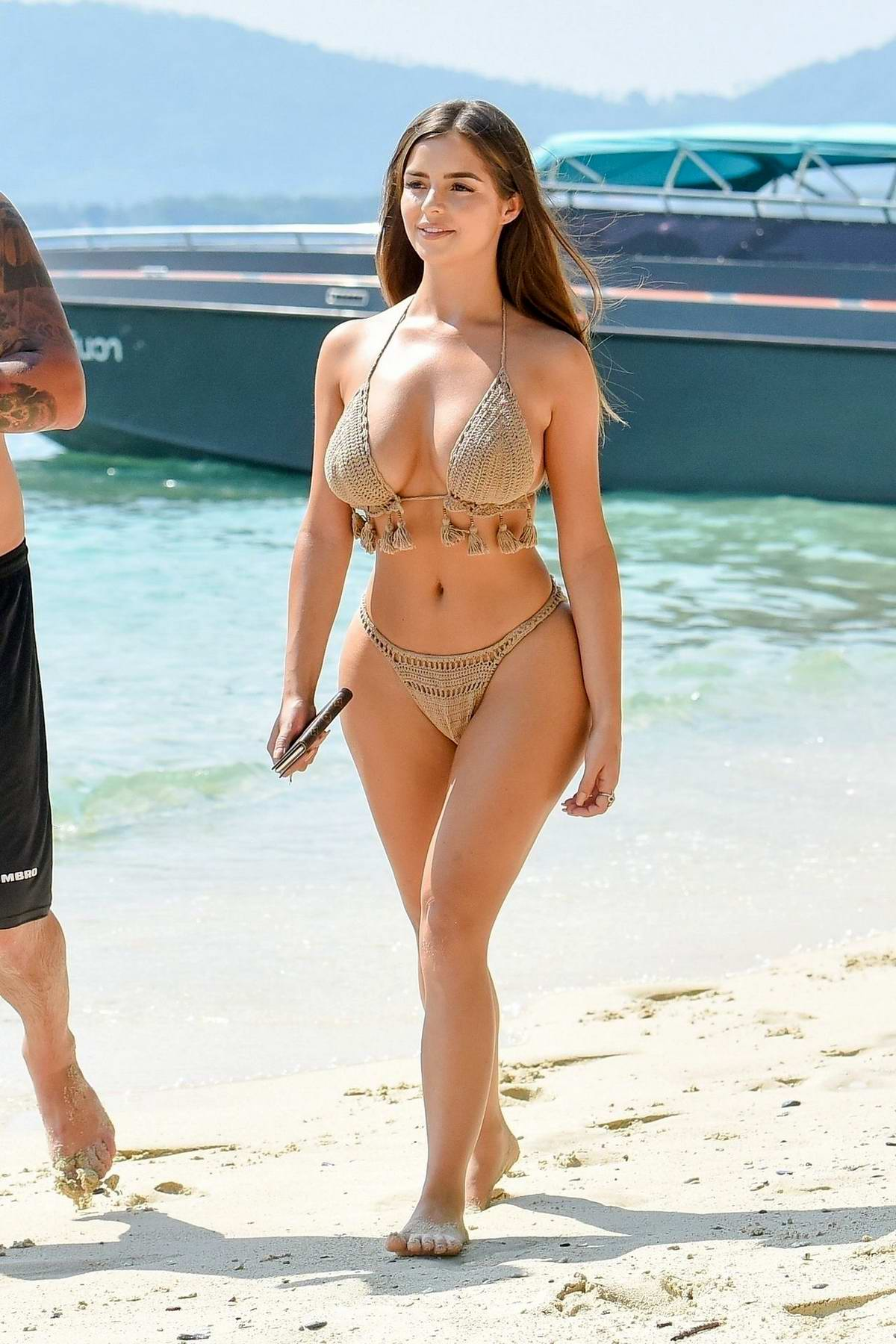 Demi Rose spotted in a beige knitted bikini during a beach photoshoot in Phuket, Thailand