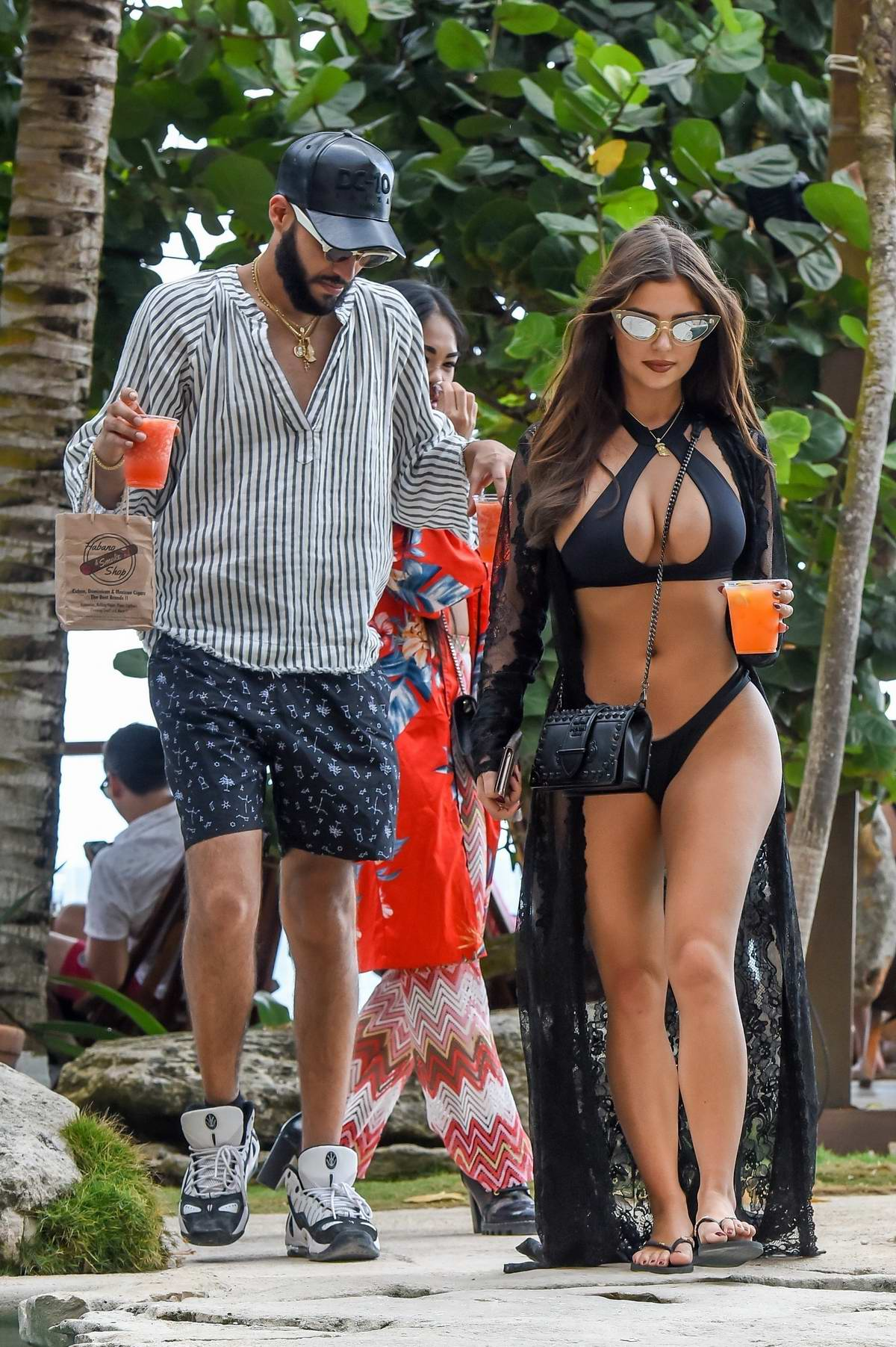 Demi Rose stuns in a black bikini while out to lunch with boyfriend Chris Martinez in Tulum, Mexico