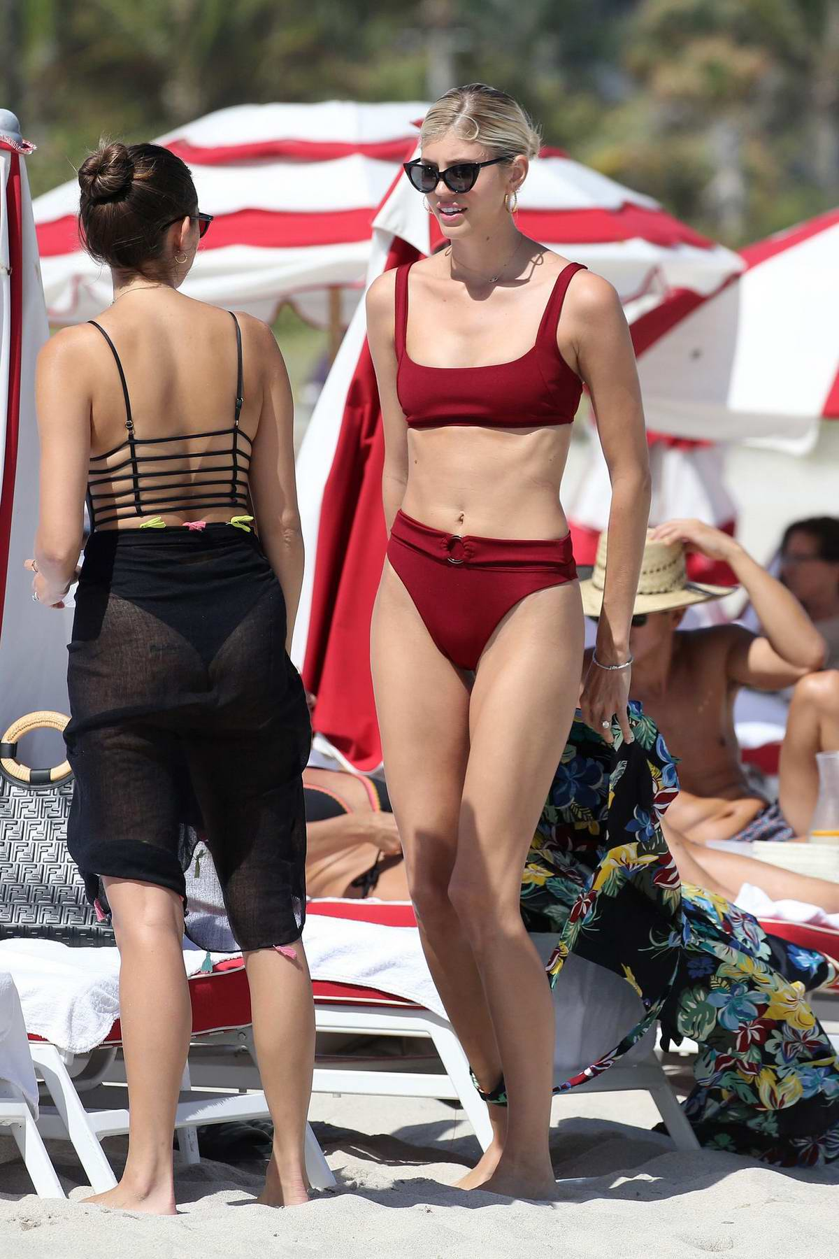 Devon Windsor dons a red bikini while enjoying a beach day at Miami Beach, Florida
