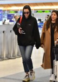 Dua Lipa spotted in a black hoodie and jeans as she arrives at LAX airport in Los Angeles