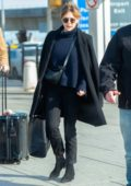 Elizabeth Olsen bundles up as she arrives at JFK airport to jet out of New York City
