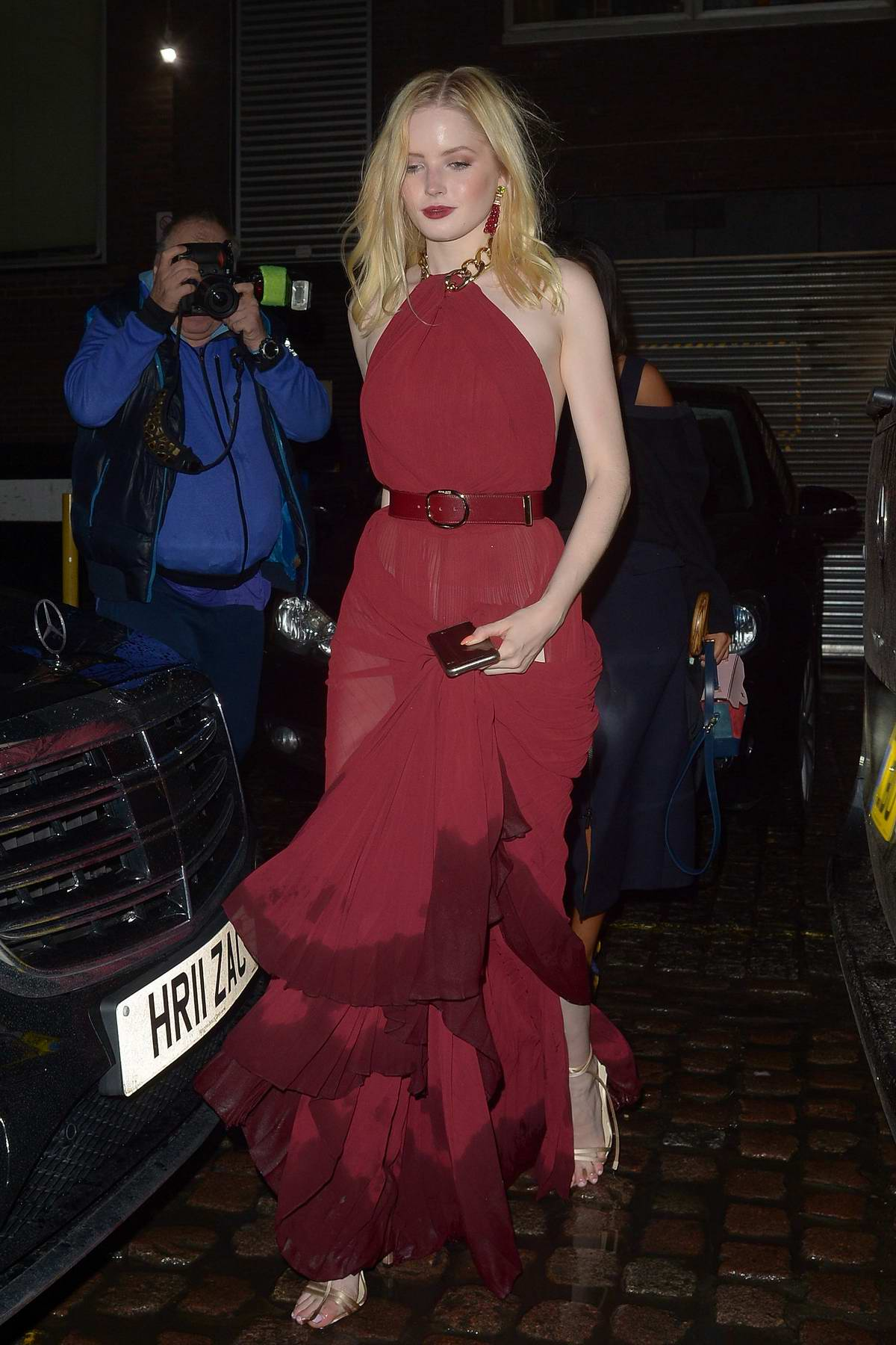 Ellie Bamber looks gorgeous in a red long dress as she arrives The Chiltern Firehouse in London, UK