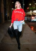 Elsa Hosk keeps it stylish with a red Chanel sweater, jeans and black thigh high boots while out and about in SoHo, New York City