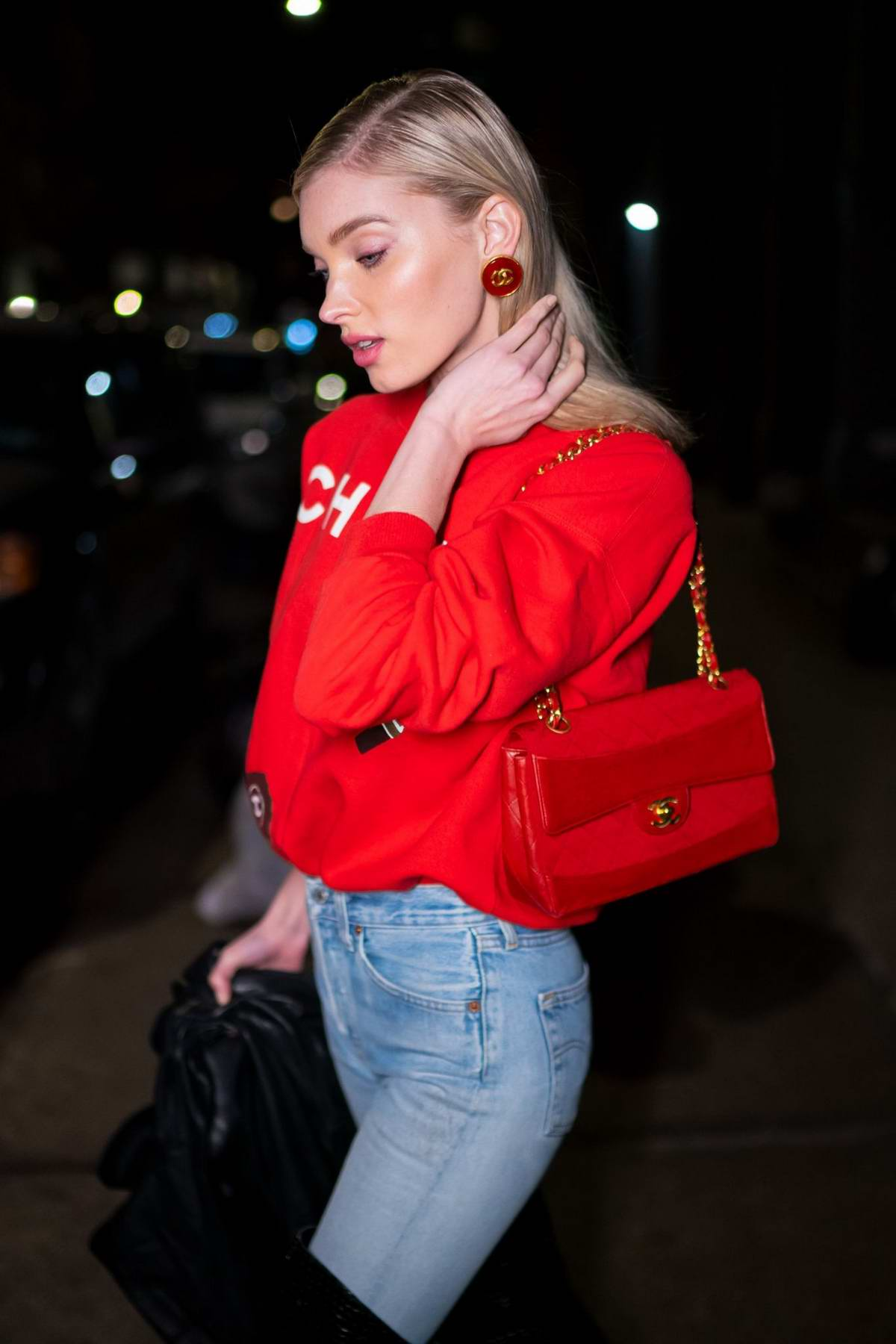 elsa hosk keeps it stylish with a red chanel sweater ...