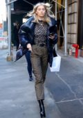 Elsa Hosk wore leopard print top and pants while attending a fitting for the Marc Jacobs for New York Fashion Week in New York City