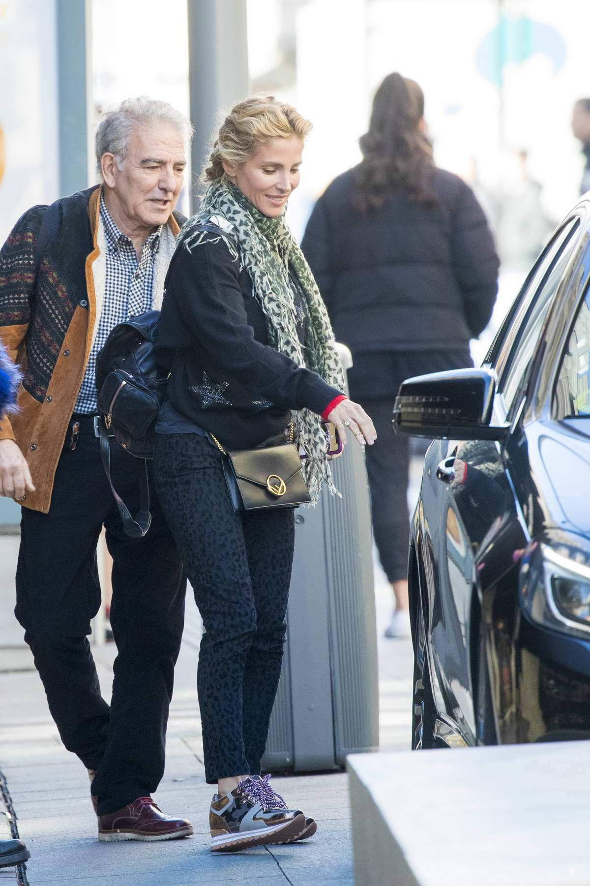 Elsa Pataky dresses in leopard print pants as she shops for wigs at Burlesque Wig shop in Madrid, Spain