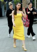 Emeraude Toubia wears a yellow dress during her appearance on 'Extra' at Universal Studios in Universal City, California