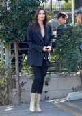 Emily Ratajkowski wore a dark grey blazer, black jeans and snakeskin boots while out for lunch with a friend in Los Angeles