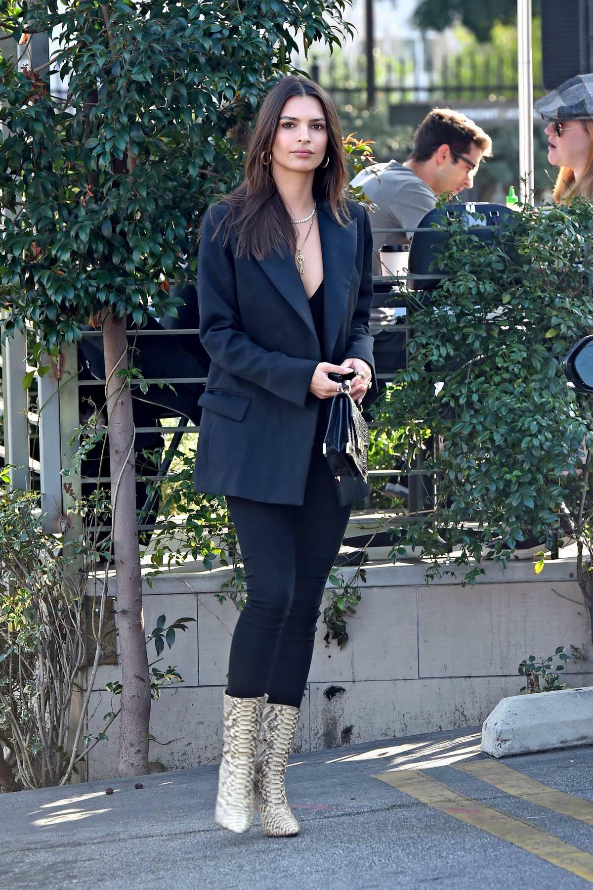 Emily Ratajkowski wore a dark grey blazer, black jeans and