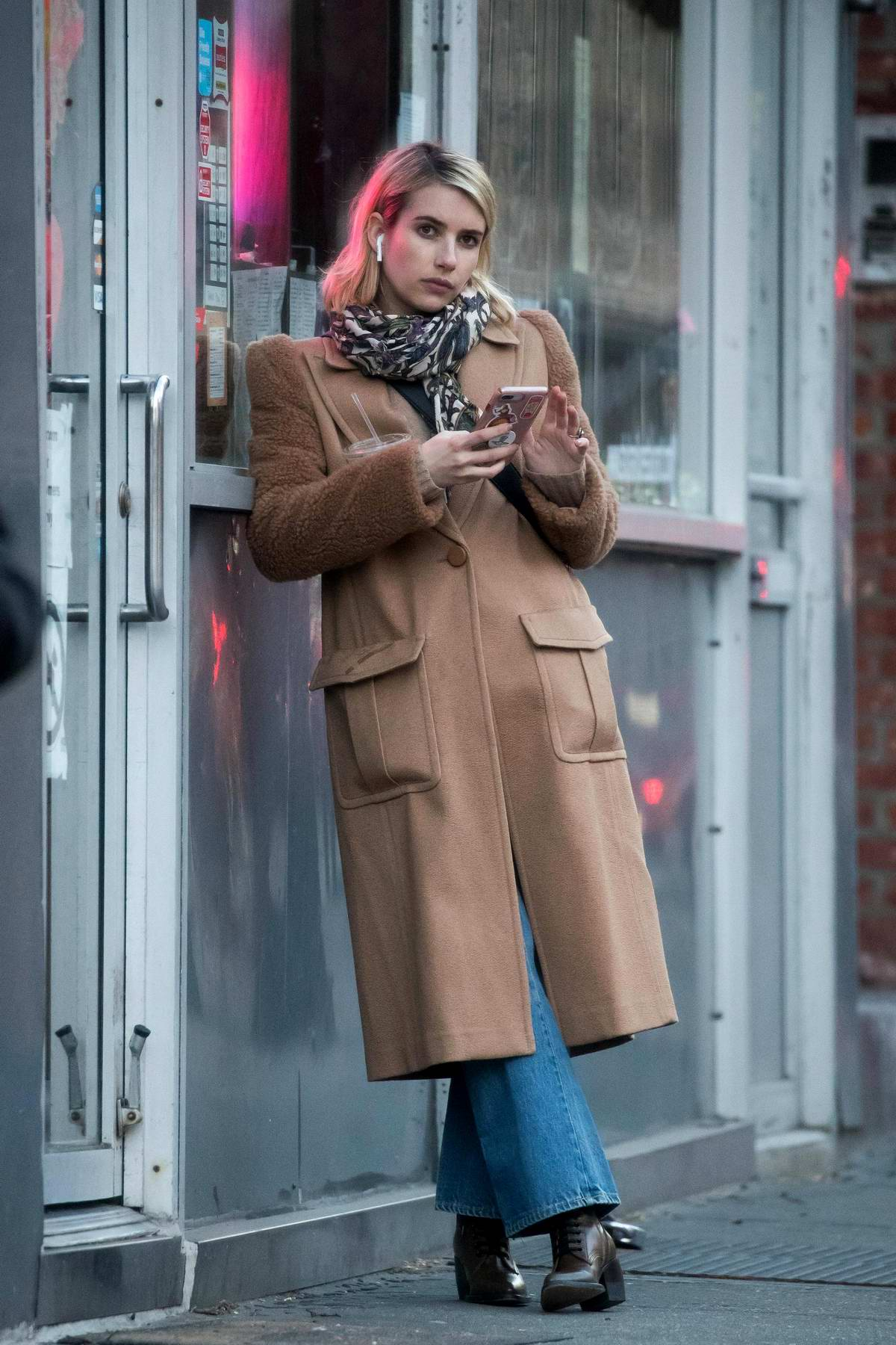 Emma Roberts looked busy on her phone while out on Valentine's Day in New York City