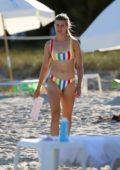 Eugenie Bouchard rocks a striped multi-colored bikini while at the beach in Miami, Florida
