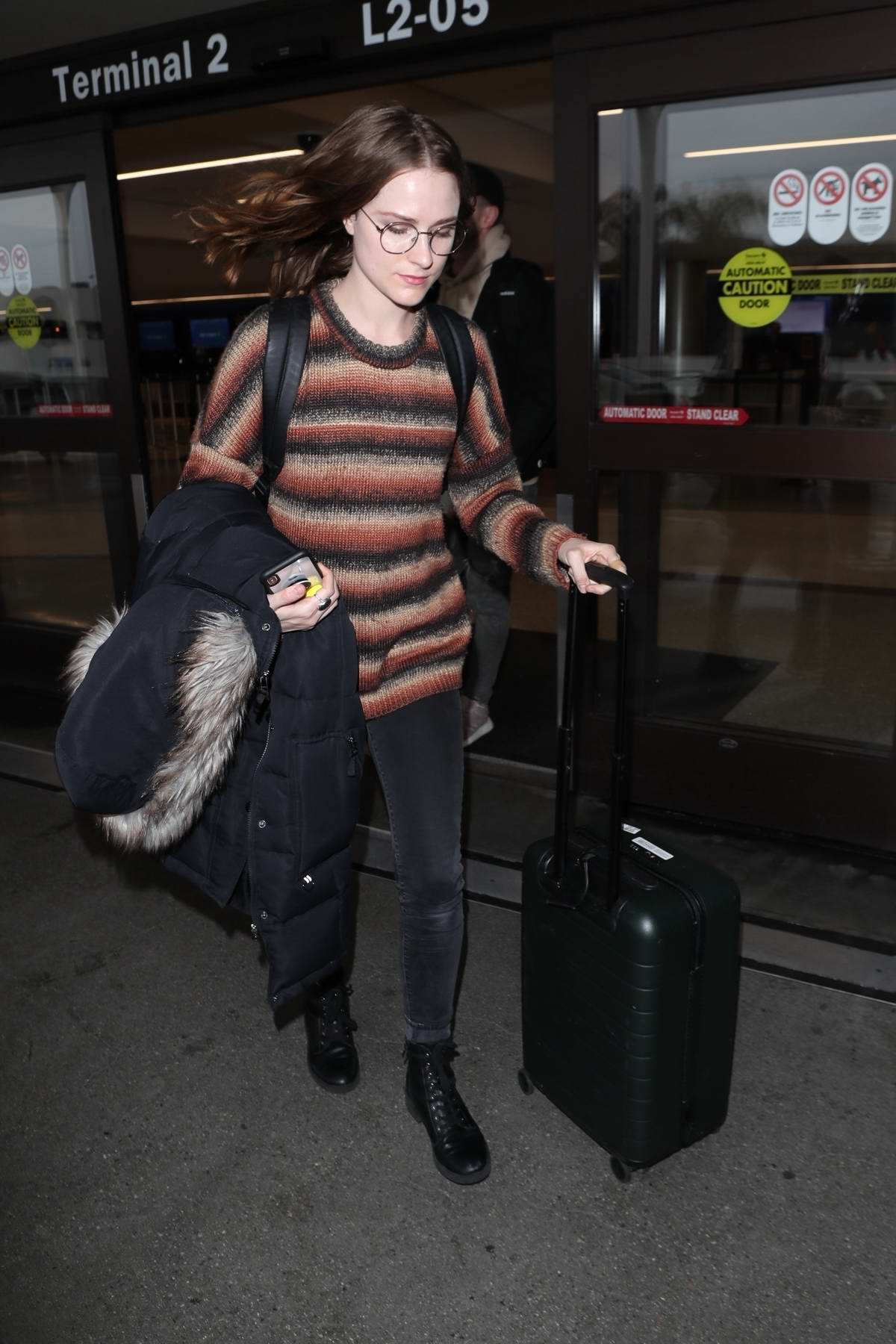 Evan Rachel Wood keeps it casual with a striped sweater and jeans as she touches down at LAX in Los Angeles