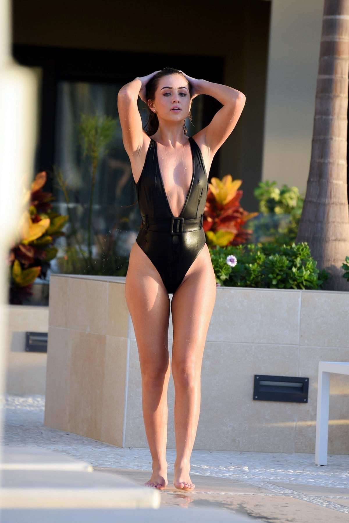 Georgia Steel wears a black swimsuit while enjoying the pool in Tenerife, Spain