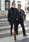 Gigi Hadid looks stylish in a black blazer with matching jumpsuit while heading to Marco Polo restaurant in Paris, France