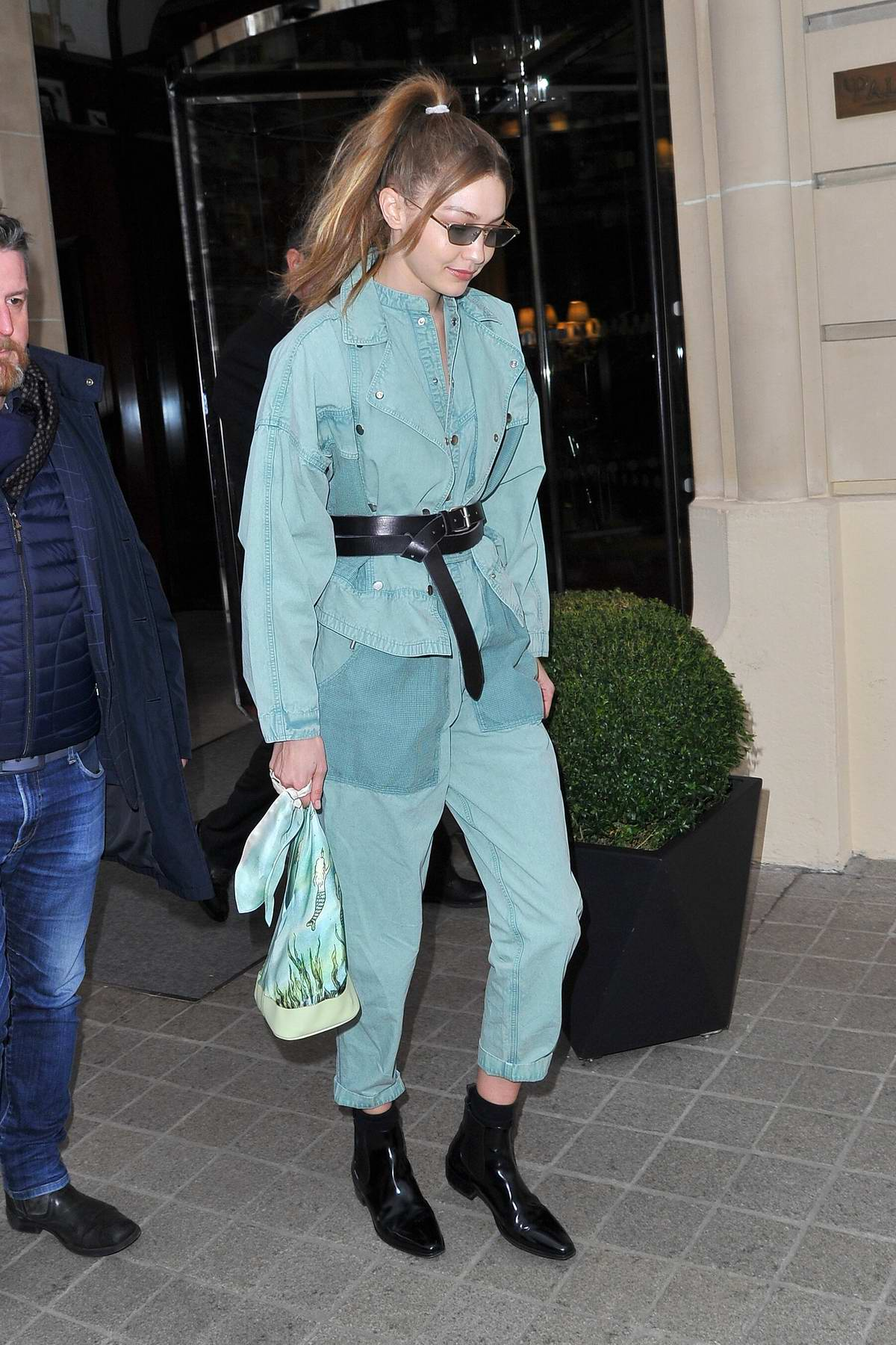 Gigi Hadid looks stylish in a mint green denim outfit as she leaves her hotel in Paris, France