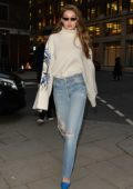 Gigi Hadid rocks an oversized turtleneck and ripped jeans while she stops by Burberry offices in London, UK