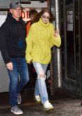 Gigi Hadid stands out in an lime green knit sweater as she arrives at Michael Kors fashion show during New York Fashion Week in New York City