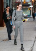 Gigi Hadid steps out in grey sweatshirt with matching sweatpants as she leaves her apartment in New York City