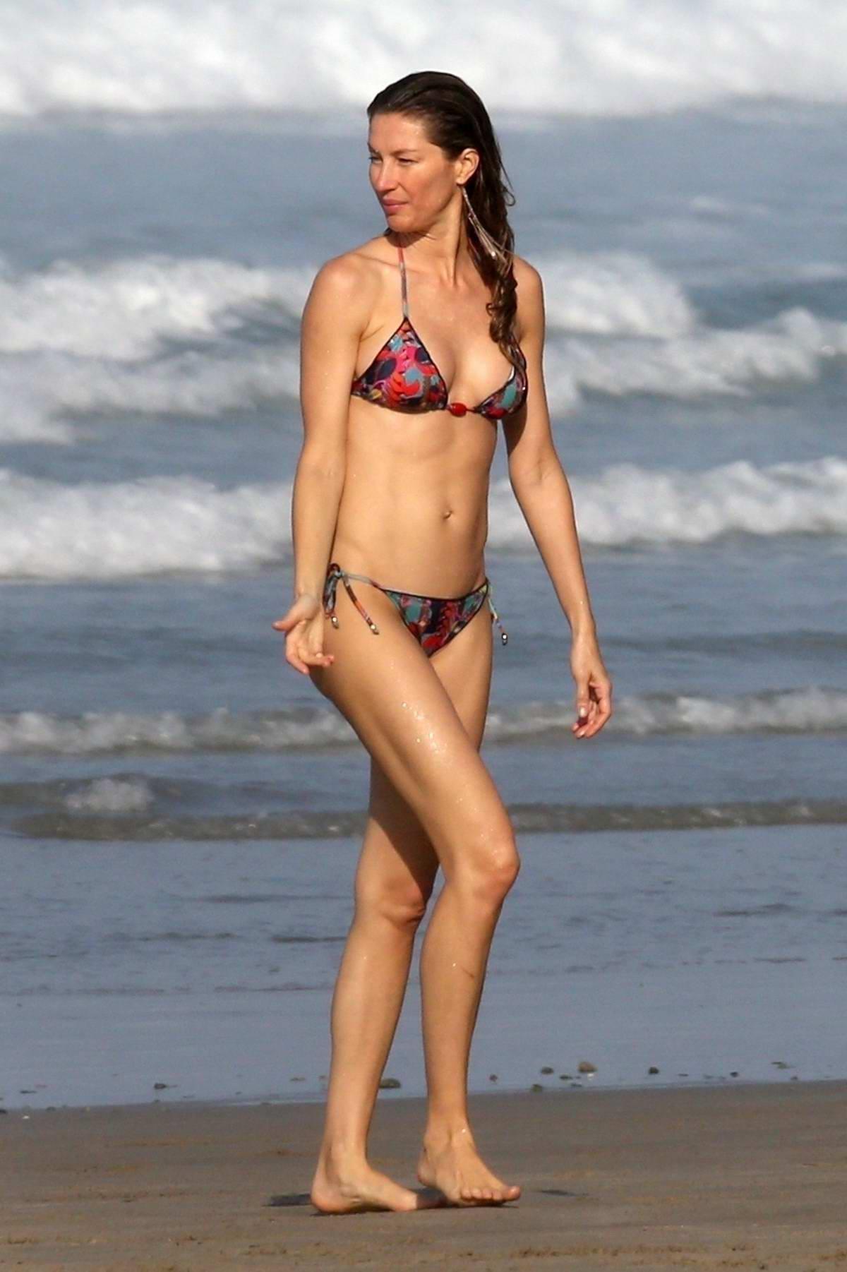 a238c245e14df Gisele Bundchen wears a colorful bikini while she and Tom Brady celebrates  Valentine s Day on the beach in Costa Rica