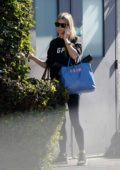 Gwyneth Paltrow wore a black sweatshirt and blue leggings while running errands in Los Angeles