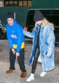 Hailey Baldwin and Justin Bieber are all smiles while Justin shows off his Louis Vuitton slippers as the couple stepped out in New York City