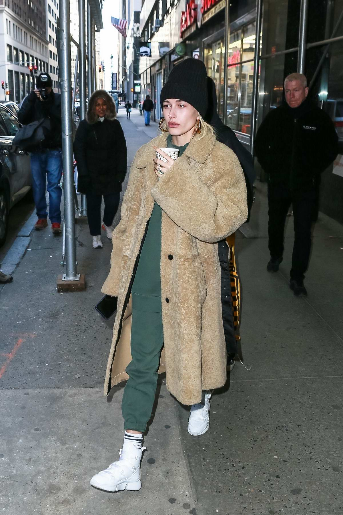 Hailey Baldwin and Justin Bieber seen leaving a building with his pastor in New York City