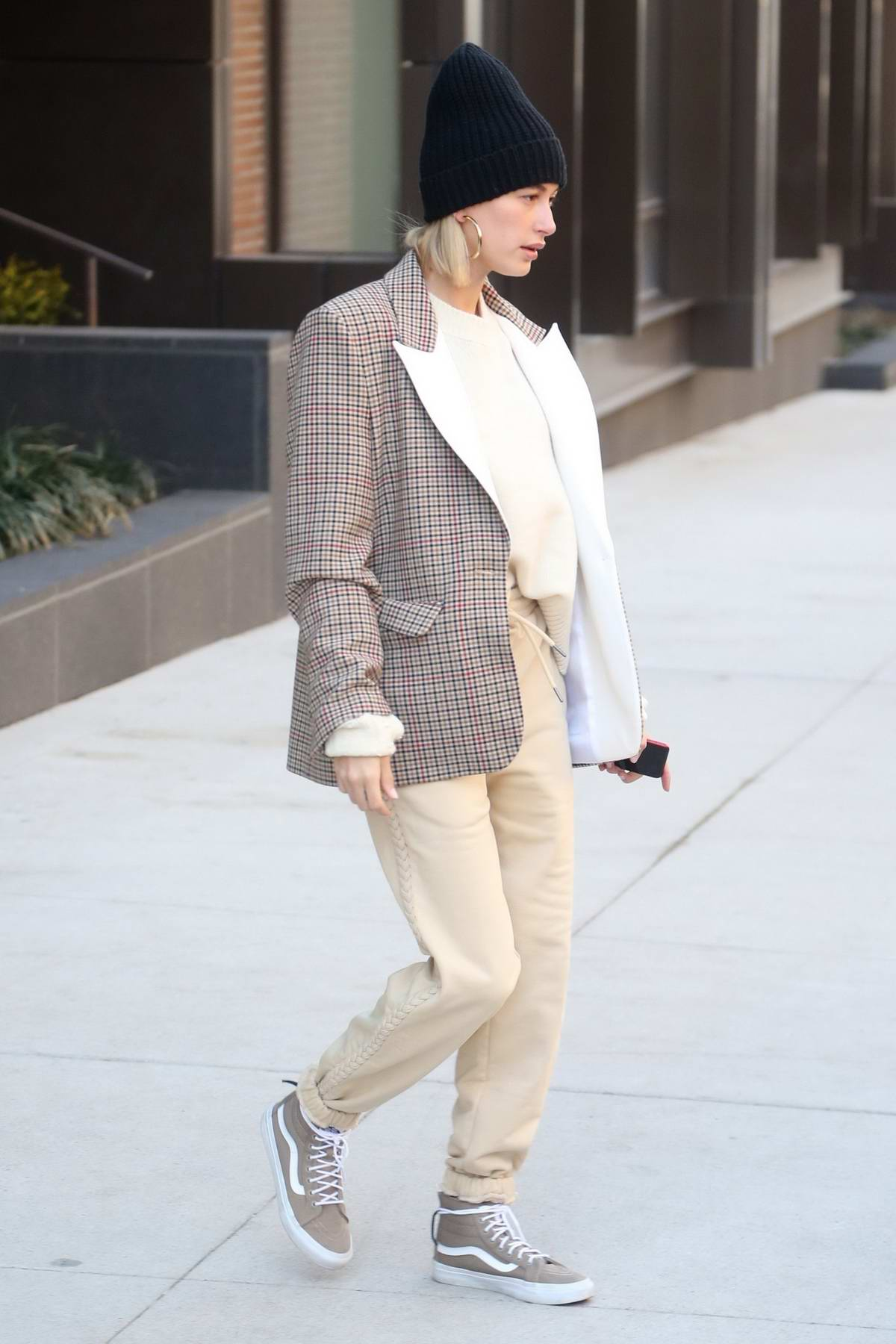 Hailey Baldwin Bieber looks trendy in a plaid blazer with khaki pants and sneakers as she steps out in New York City