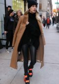 Hailey Baldwin Bieber wears a brown coat with an all black ensemble as she heads out in New York City