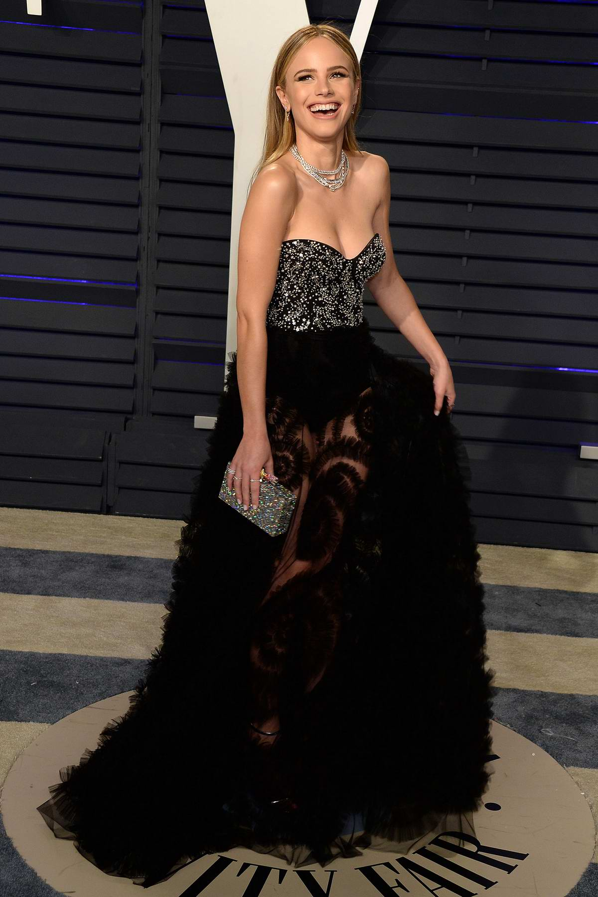 Halston Sage attends the Vanity Fair Oscar Party at Wallis Annenberg Center for the Performing Arts in Beverly Hills, California