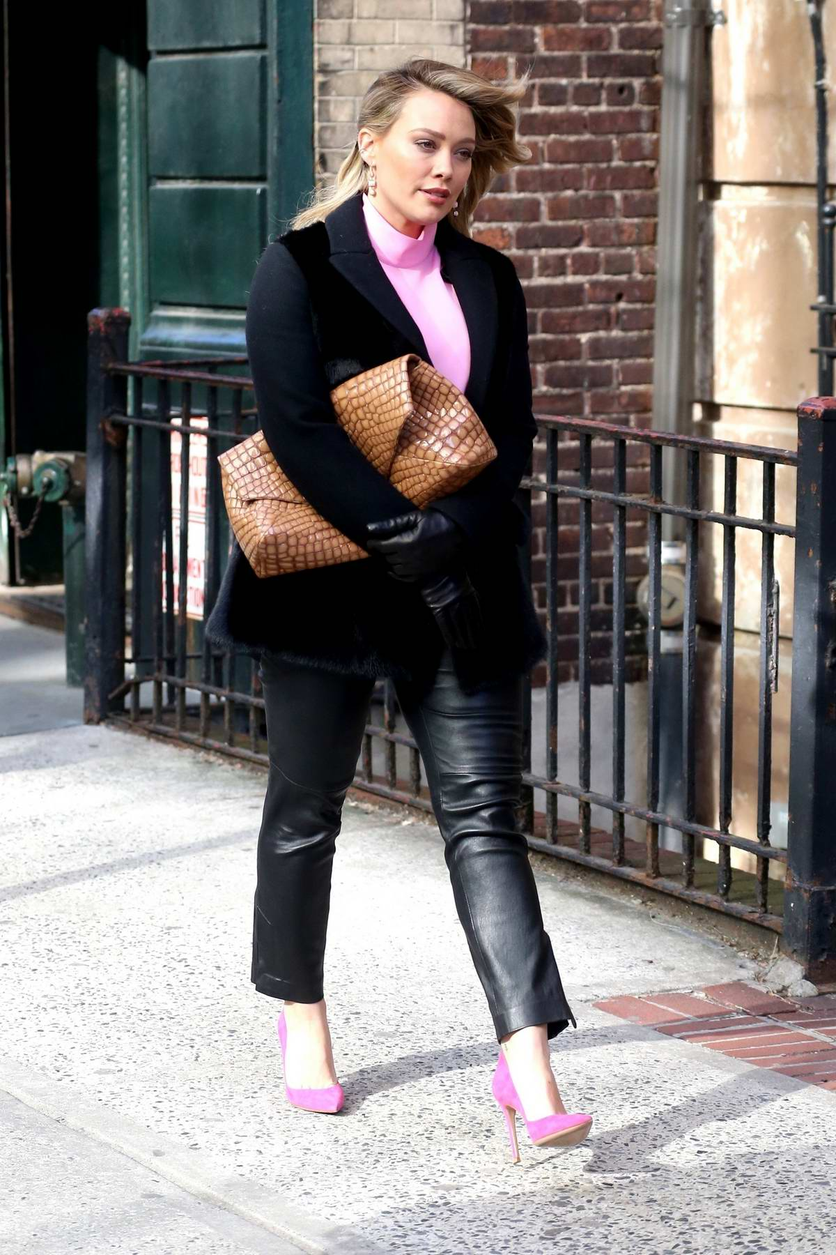 Hilary Duff rocks black and pink while on the set of 'Younger' in New York City