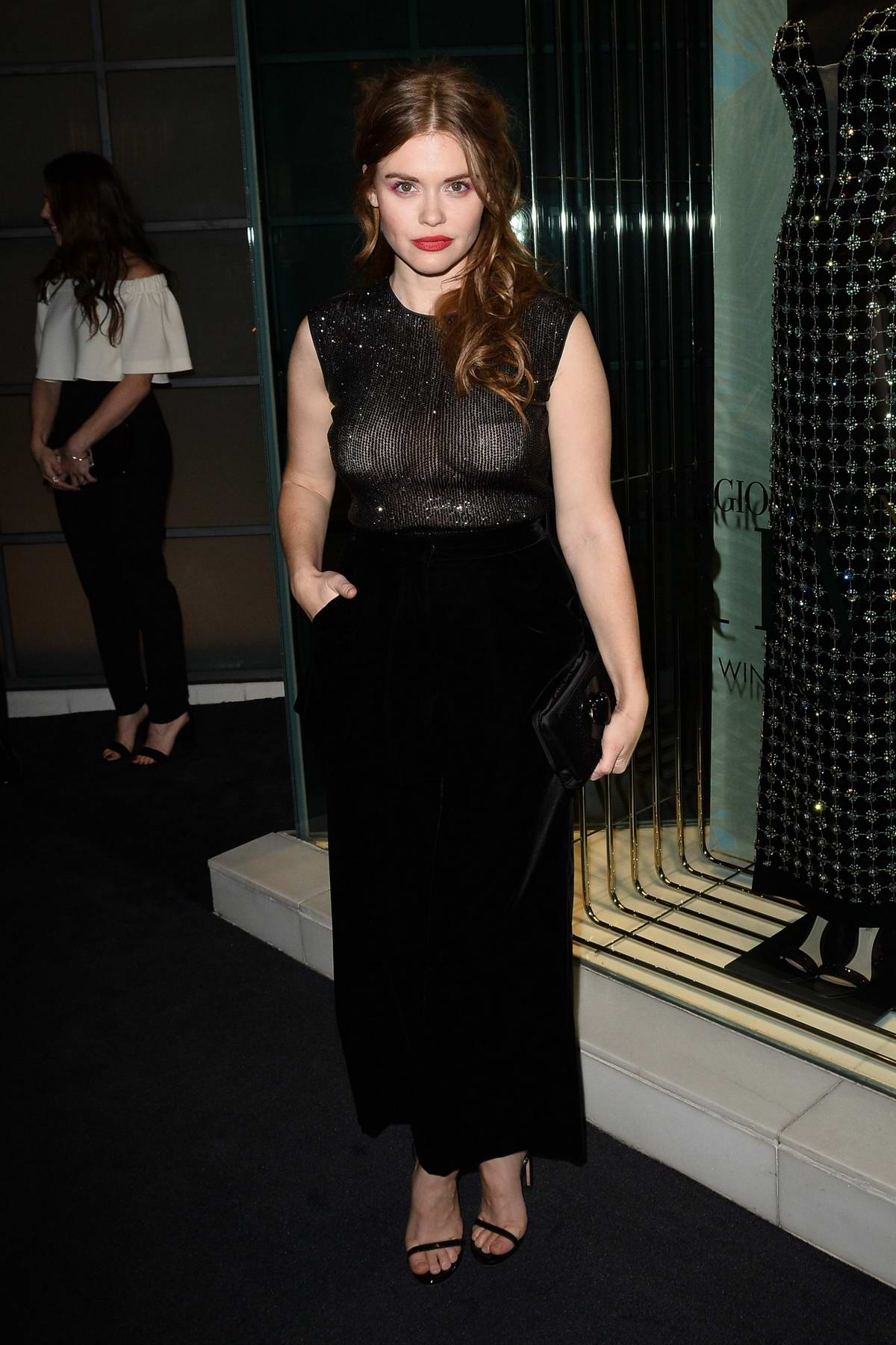 Holland Roden attends the Giorgio Armani Pre-Oscar Party in Los Angeles