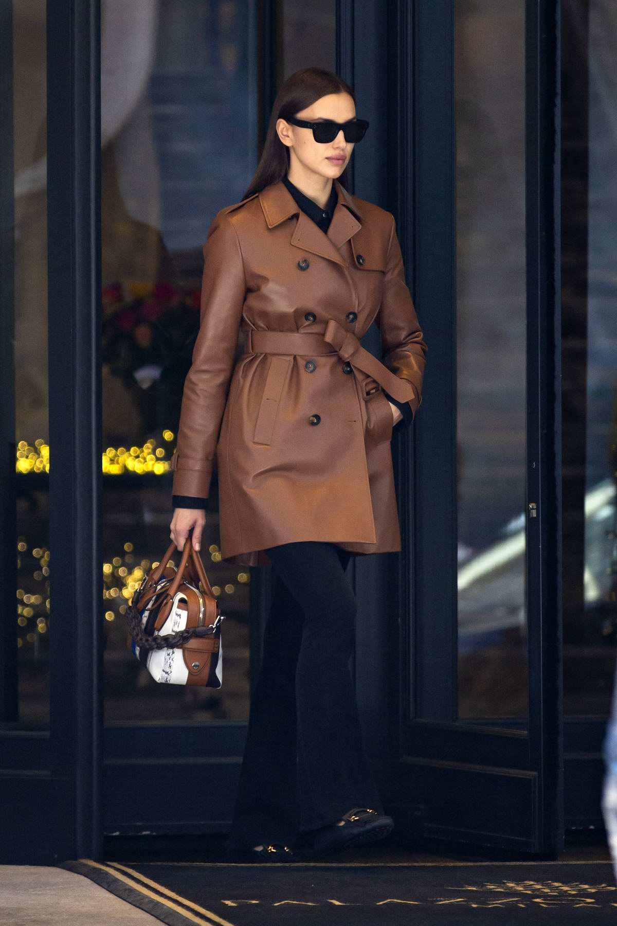 Irina Shayk looks chic in a brown leather jacket while shooting a commercial for Tod's in Milan, Italy
