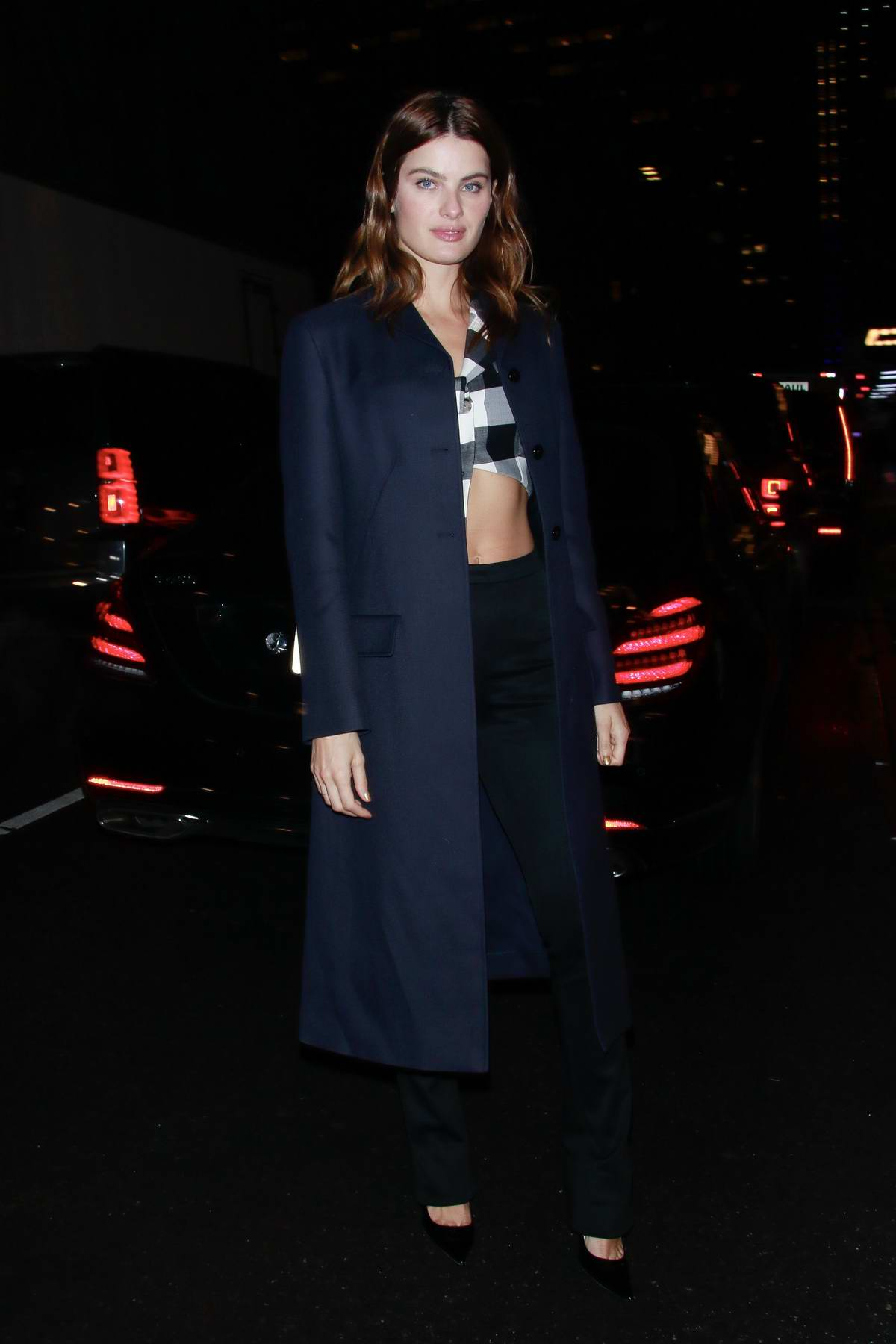 Isabeli Fontana looks chic in a navy blue blazer with a plaid crop top and black trousers during a night out in New York City