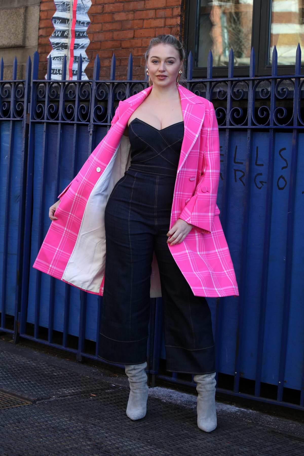 Iskra Lawrence stuns in a bright pink blazer with blue denim jumpsuit while out in Soho, New York City