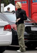 Jamie King shops for some dried decorative branches at the Farmer's Market in West Hollywood, Los Angeles