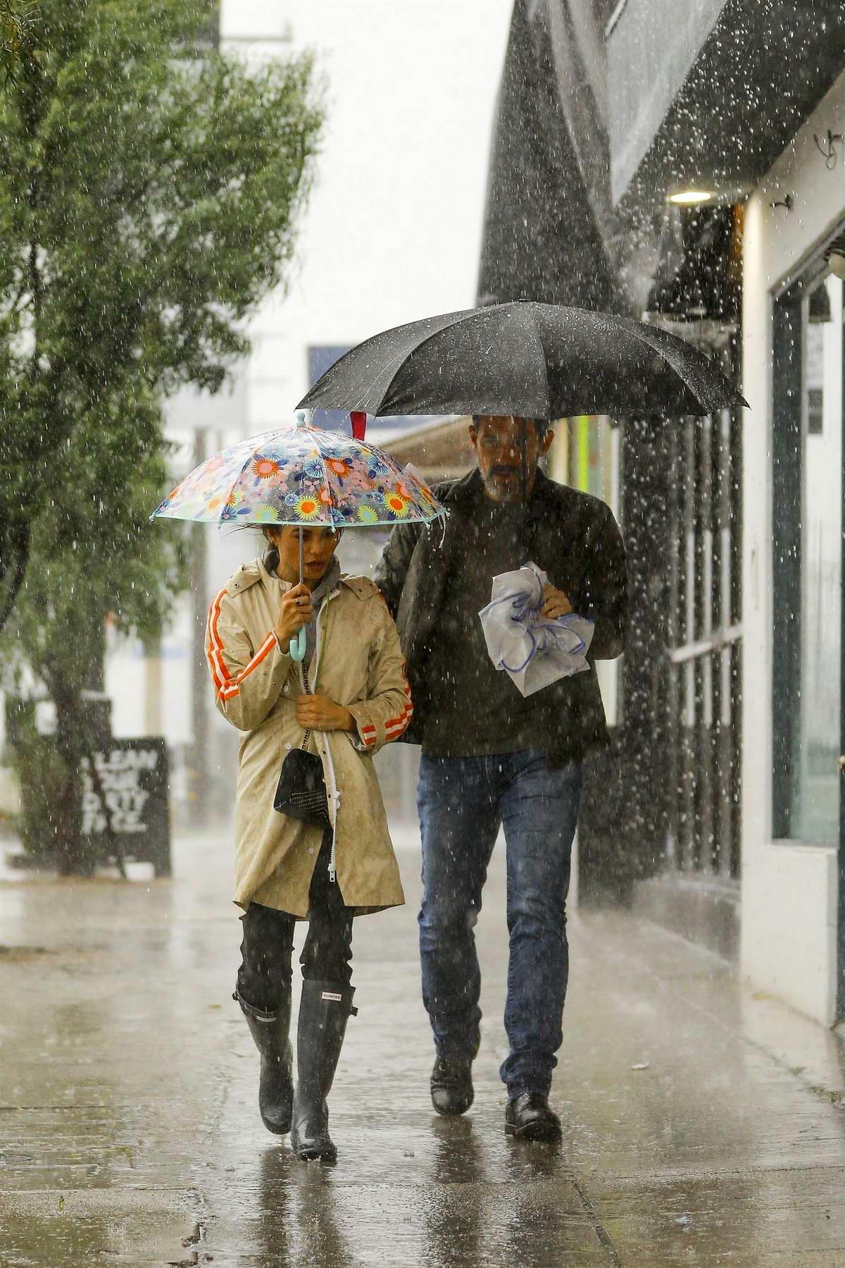 Jenna Dewan and boyfriend Steve Kazee brave heavy rain to run errands in Los Angeles