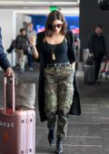 Jenna Dewan looks stylish in a long black cardigan with a black tank top and camo pants as she arrives at LAX Airport in Los Angeles