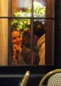 Jennifer Lawrence and Cooke Maroney share a kiss during a romantic dinner at a restaurant in New York City