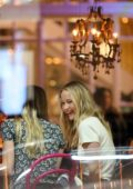 Jennifer Lawrence flashes her engagement ring during a girl's night out in New York City