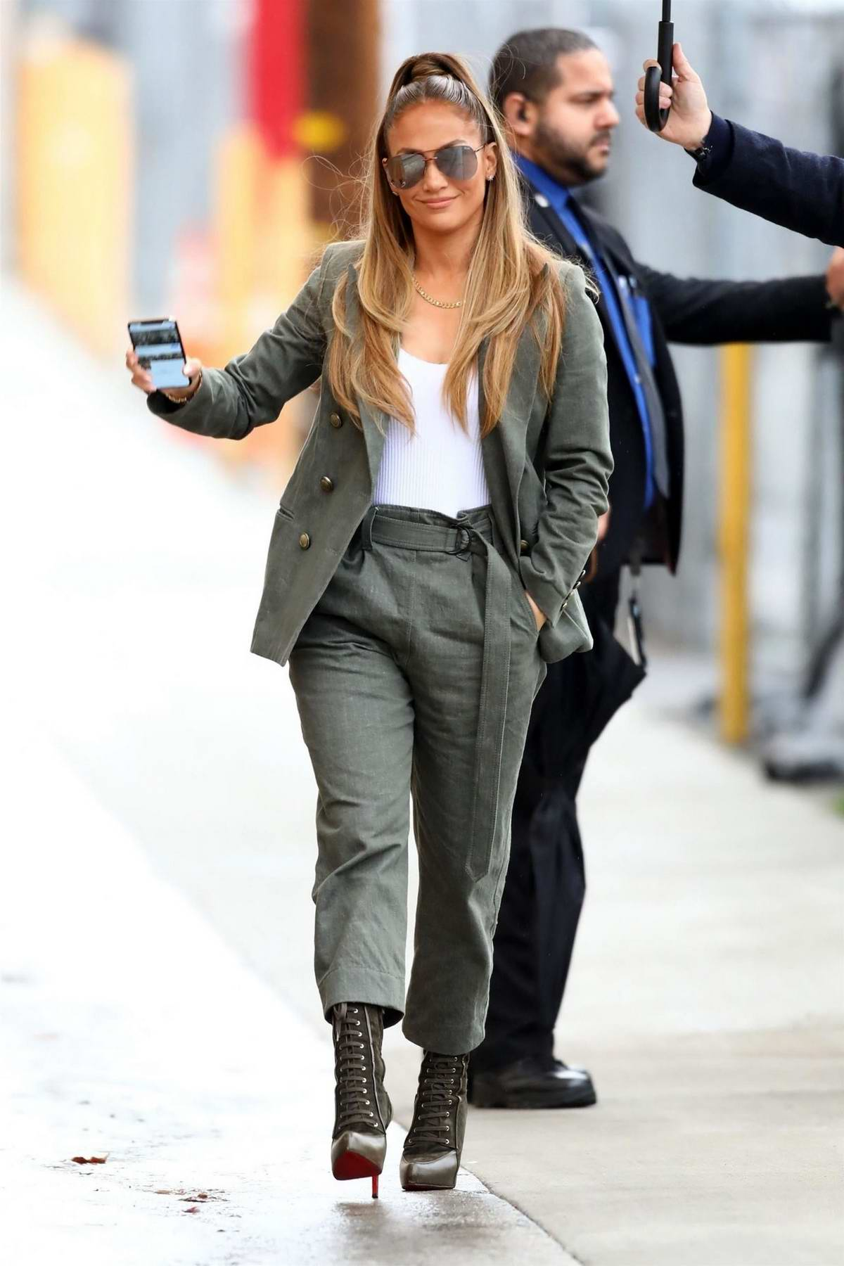 Jennifer looks stylish in a grey jacket, white tank top, grey pants as she arrives at Jimmy Kimmel Live! in Hollywood, Los Angeles