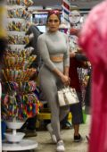 Jennifer Lopez looks sporty in a grey crop top with matching leggings while shopping at a candy store with her kids in Miami, Florida