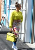 Jennifer Lopez rocks a neon green crop top and colorful floral print leggings as she arrives at the gym in Miami, Florida